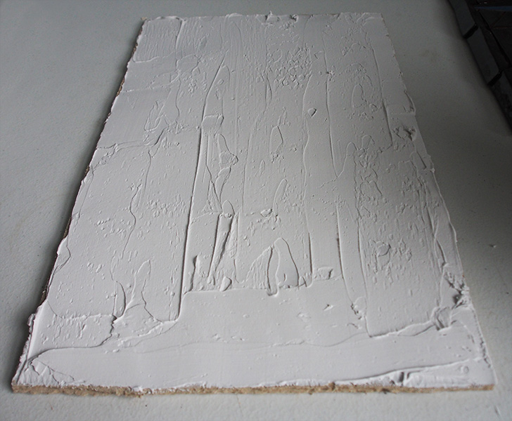 tile adhesive applied to backer board