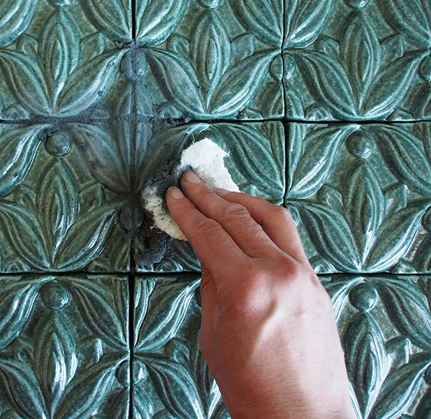 grouting high-relief tile with cheesecloth