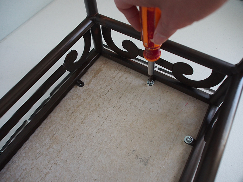 attaching the mosaic tabletop to the base