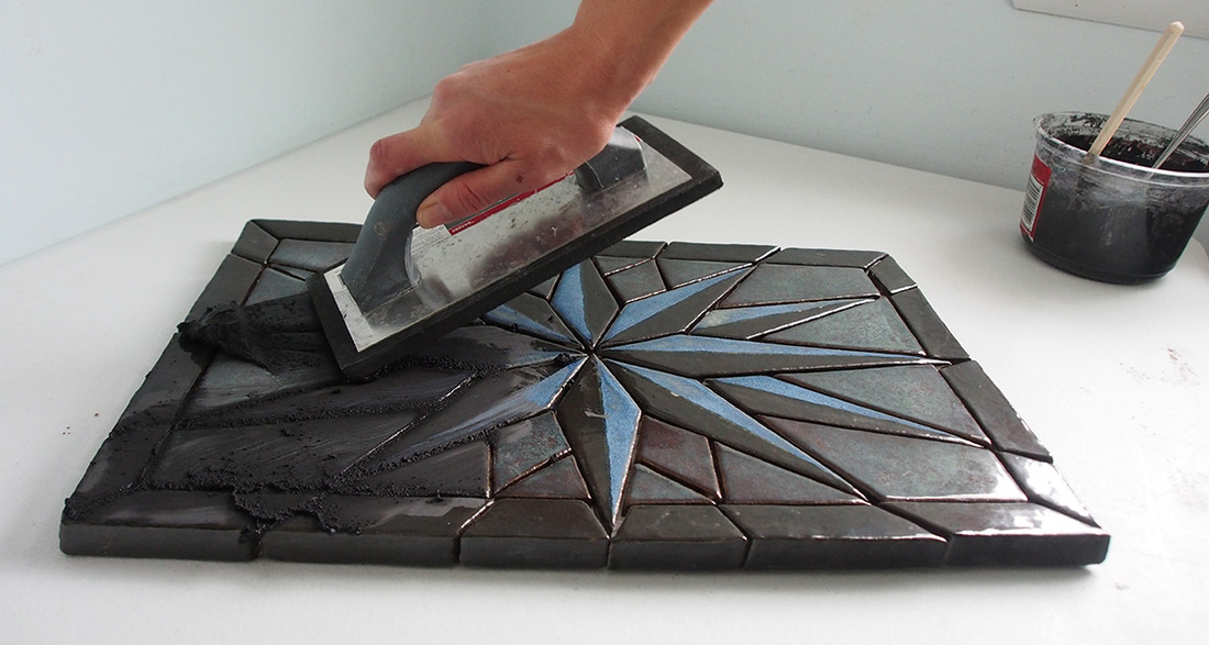 grouting using a rubber trowel