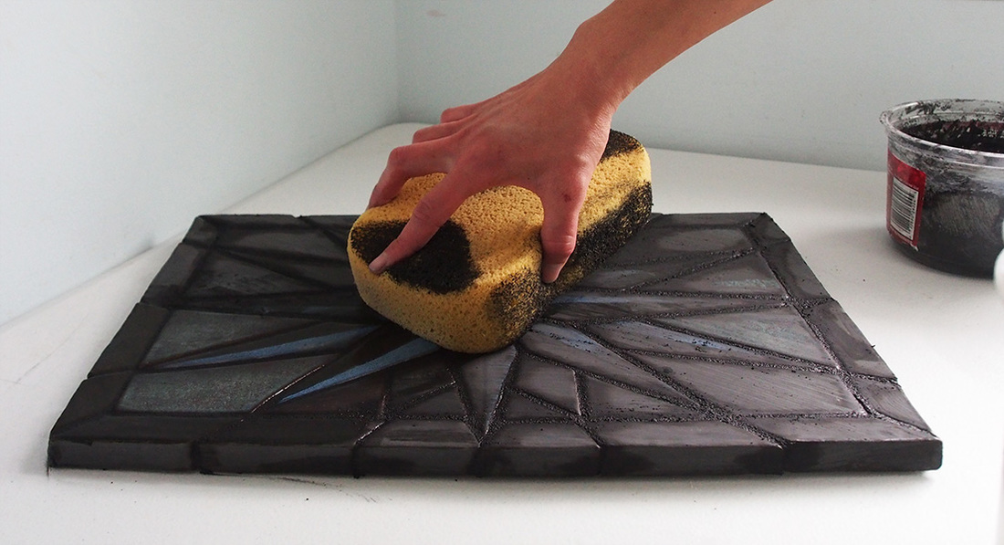 using a sponge to clean grout
